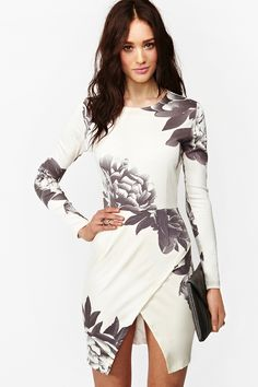 The tulip split makes me hesitant to buy...I'm not confident sitting-without-exposing is possible. Madison Floral Dress, $220.