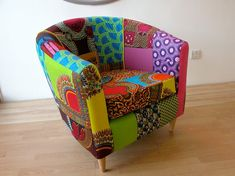 a chair made from african fabric. amazing. etsy.