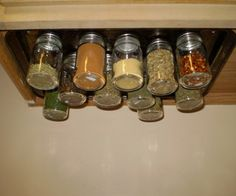 Old cookie sheet turned under counter spice rack.   Super Easy (and Cheap!) Magnetic Spice Rack