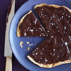 Chocolate-Salted Caramel Tart Ingredients    4 sheets frozen phyllo dough, thawed  Cooking spray  1/4 cup sugar  1/2 cup heavy cream  2 ounces fine-quality bittersweet chocolate, coarsely chopped  1/4 teaspoon flake sea salt, plus more for garnish  Preparation    1. Preheat oven to 350°. Line a baking sheet with parchment paper and set aside.    2. On a clean cutting board, place one piece of phyllo dough and spray generously with cooking spray. Add another layer of the phyllo and repeat; fin...