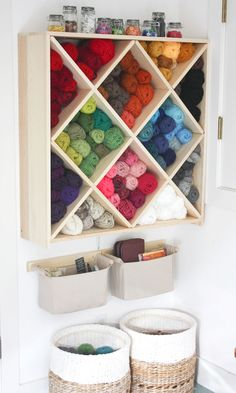 A beautiful way to store yarn. I would love to organize my yarn like this but I worry it would get all dusty.