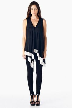 Cascading Layered Top with White Hem.
