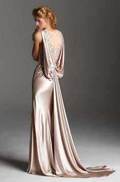 Luxurious draping to say nothing of the beaded back