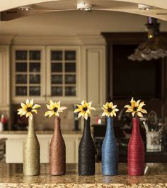 A great way to upcycle old wine bottles using twine to make beautifully colored vases!