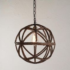"""Twig Sphere Chandelier or Pendant Light                   This globe, made from wired twigs, is really down to earth with its natural style and bronze hardware. In a larger size (20""""Hx19""""W) for kitchen tables and entry foyers or in a smaller size (14""""Hx13""""W) for hanging over stone counters and potting tables"""