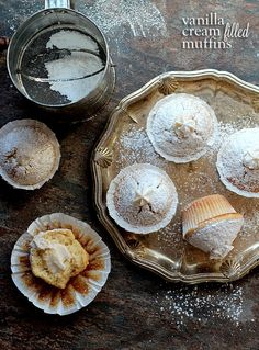 Vanilla Cream Filled Powdered Sugar Muffins | Cookies and Cups