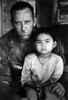 US soldier with a South Vietnamese child, Vietnam (Philip Jones Griffiths, 1967)