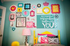 What a great gallery wall for a girls room or playroom!