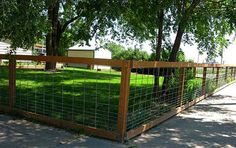 """This inexpensive fencing solution is constructed using only three parts: treated 4""""x4"""" fence posts, treated 2""""x4s and galvanized hog panels. No stretching is required and since there is no sideways pressure on the fence posts, stout corner bracing is unnecessary."""