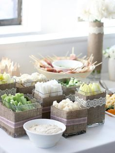 beautiful food display: clear containers wrapped in linen/burlap + lace
