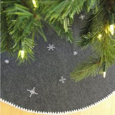 We love that this Snowflake DIY Tree Skirt doesn't stick to the traditional red and white color scheme. Plus, the embroidered snowflakes and white edging are so pretty!