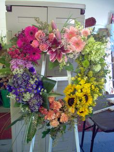 Fresh Arrangement made for a funeral by  Deb's Flowers & Gifts