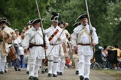 Soldiers marching in Greenfield Village to celebrate America.