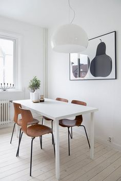 Black, white, wood dining. Love those pears.