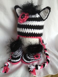 Baby girl Zebra UGG booties and Ear flap hat by cmiron on Etsy, $48.00