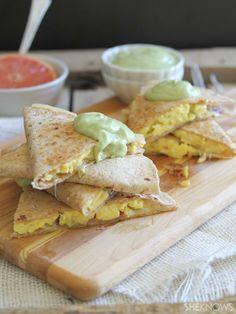 Bacon egg and cheese quesadilla stacks with avocado hollandaise sauce!
