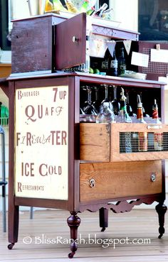 Old dresser turned portable bar for cocktails. #repurposed #upcycled