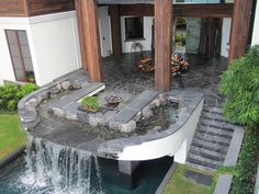 Backyard pool waterfall and patios. The stone is black slate from Virginia