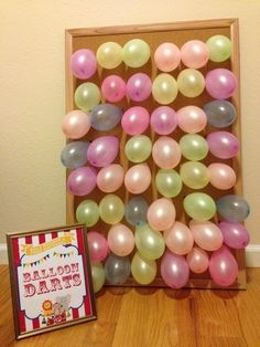 Balloon darts carnival game Use card board in place of cork board to save cost