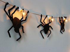 Easy Spider Strand Lights DIY >> http://blog.diynetwork.com/maderemade/how-to/spooky-spider-strand-lights/?soc=pinterest