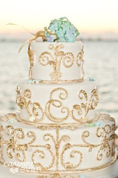 My wedding cake inspired from an Italian gate. White butter cream dusted with gold.