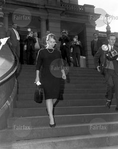 Pam Logan arrives at Central Court, Sydney, to give evidence in the Bogle-Chandler murder inquiry, 24 May 1953. Miss Logan was the girlfriend of Mr Chandler whose wife, Mrs Chandler, was found murdered with her lover, Mr Bogle, on the banks of the Lane Cove River. many innocent people were smeared by the strange deaths including Miss Logan. The deaths and the inquest became a media circus.