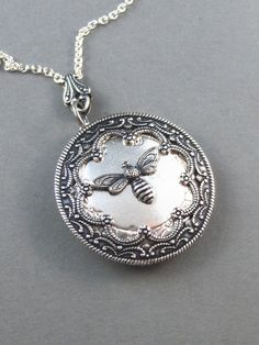 Queen Bee Silver Locket. Antiqued Silver,Charm,Wings,Honey,Mother.  Handmade jewelery by valleygirldesigns on Etsy. on Etsy, $29.00