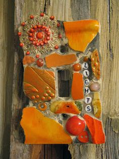 LIGHTS mosaic single switch plate in oranges.