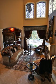 Tableaux faux iron for the top windows and an iron cornice with velvet draperies for the bottom window.