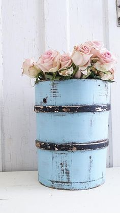 This is a vintage ice cream bucket that has been painted a lovely shade of blue.It measures 13 1/2 x 10.I love using these for decor purposes,adding a vase tucked inside for flowers as shown,or dried flowers too.Would be great to store extra bathroom tissue,or showcasing some long bread boards.The possibilities are endless!Price includes shipping to US only,at this time we do not ship to Alaska or Hawaii.