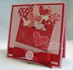 envelope busting with hearts