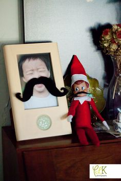 Elf on the Shelf: Snitch is mocking Eli's funny mustache photo. How'd he grow that mustache overnight?
