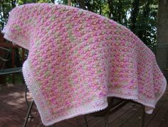 """Bernat Softee Baby in """"Tulips"""" The blanket is a simple shell back and forth to desired width and length."""