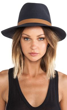 such a cute hat! and love her hair too!