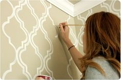 wall stencil.  gold and cream, pretty