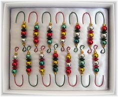 make your own ornament hooks; dress them up with beads, ribbon, etc.