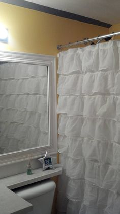 Ruffle shower curtain. Kids bathroom.