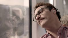"""""""I love the way you look at the world.""""  Joaquin Phoenix is Theodore in Her."""