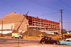 Veterans Memorial Auditorium, under construction - 1954. This at the time was partially a residential neighborhood [see house at far right] positioned between downtown Des Moines and Mercy Hospital, years before the construction of I-235