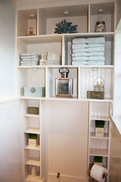 Small Space Storage Ideas: Install wall-to-wall and floor-to-ceiling shelves around the toilet to create much needed storage space. This could work in our bathroom now.