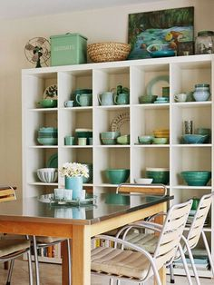 ikea expedit in kitchen - perfect for displaying collections. Someday I will fill a wall with Fiestaware!
