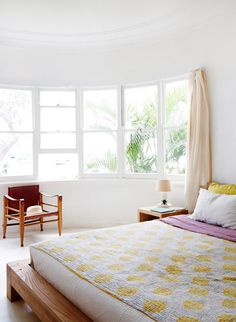 White walls + yellow quilt