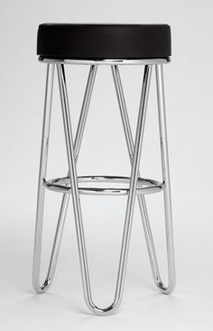 The Marcel Breuer B114 Stool was first shown in the Thonet catalogs of the 1920s.  The Thonet company subsequently produced a variation of this stool and credited Emile Guillot with the design.