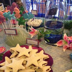 Food ideas for a under the sea party or little mermaid party - peanut butter and jellyfish sandwiches and candy pop fish - cute!
