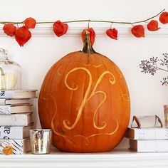 Monogram your pumpkins for a glamorous look! Find more ideas here: http://www.bhg.com/halloween/pumpkin-carving/cool-halloween-pumpkins/?socsrc=bhgpin090214monogrampumpkin&page=4