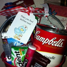 Get Better Soon Bucket: water, chicken noodle soup, gum, chocolate, chap stick, anti-bac sanitizer, tissue, playing cards, sticky notes, memo pad, and pens!