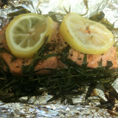 Salmon grilled in foil. Light olive oil and splash of white wine to help steam the fish. Dash of kosher salt and fresh pepper, lemons and tarragon. Wrap in little pouches. Grill on medium heat for 15 minutes.