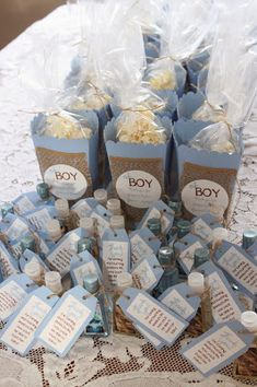 baby blue oh boy burlap baby shower favors.  Mini Handsanitizers with handmade tags.  Handmade popcorn boxes using the silhouette cameo.  my dirty apron  @silhouettepins