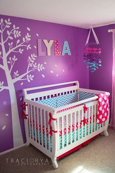 This momma was not afraid to mix patterns and bold colors in her girly chevron and polka dot nursery!