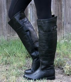 Black riding boots with back buckle detail and side zipper